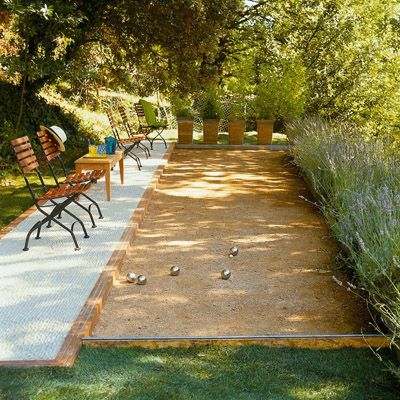 Pétanque court. Do they mean Bocci? Remember to make one in our backyard, Not exactly like this one, but it has some good ideas.
