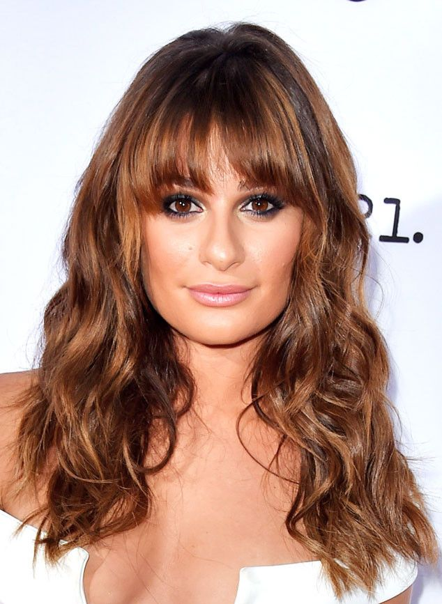 Lea Michele's hair color is all about blending rich chocolate and caramel shades into one decadent and glossy tint. (Click for more hair 'dos we love!)