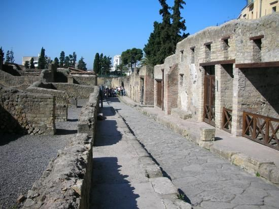 Italy. Pompeii. Pompeii is a Roman town frozen in time, thanks to a devastating eruption of Mount Vesuvius in 79 AD. Explore houses from modest to majestic; see Roman shops, baths and brothels; or apply your high-school Latin to the graffiti that's still visible on some of the walls.