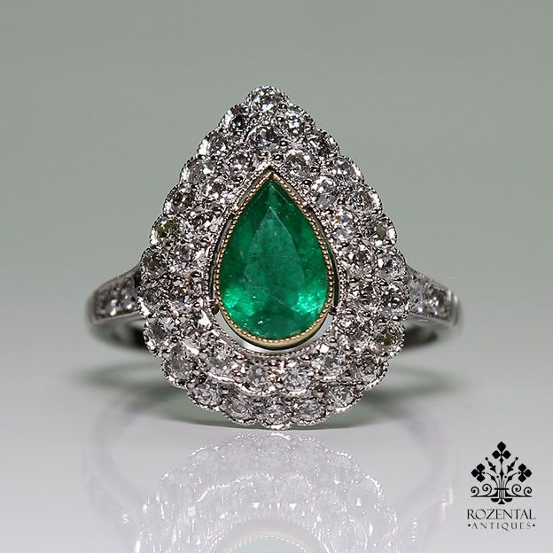 Period: Art deco (1920-1935) Composition: Platinum. Stones: - 1 Natural drop cut Colombian emerald that weighs 1ctw. - 48 Old mine cut diamonds of H-VS2/SI1 quality that weigh 1.10ctw. Ring size: 7 Ri