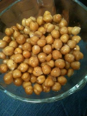 1 can of garbanzo beans, rinsed and dried Drizzle of olive oil Spices of your choice (cayenne pepper, sea salt and pepper, Italian spices, etc) Preheat oven to 400 degrees. Rinse can of garbanzo be…