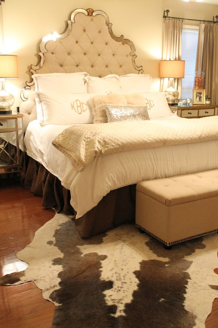 Lovely This Curvy Tufted Headboard Makes A Grand Statement In This Creamy Master  Bedroom Design. LOVE The Cow Hide Rug