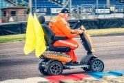 Wheelchair-user Steve Tarrant, 55 from Poole, has achieved an international marshalling award for his 30-years of endurance motorsport officiating - made possible by ownership of an 'orange racing style' TGA Vita mobility scooter.  http://www.tgamobility.co.uk/2016/01/04/goodwood-f1-crash-survivors-tga-vita-mobility