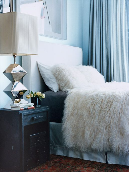 Modern Simple Clean Bed Room  White and Powder Blue with Chrome accent lighting.