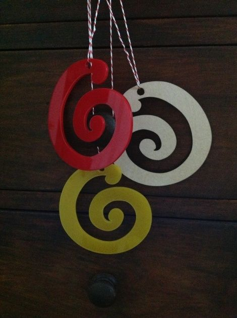 Koru Decorations in FSC approved ply, scarlet and yellow acrylic
