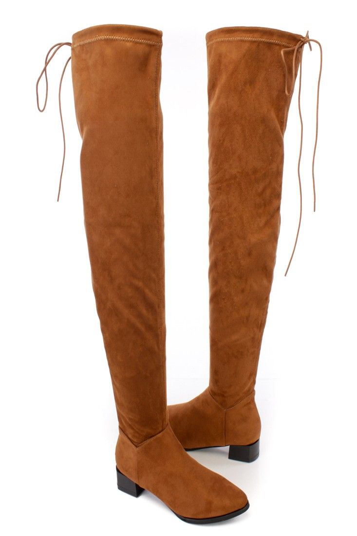Thigh high boots are a girls best friend. Featuring a bold color with a faux suede fabric, stitched detailing, round close toe, lace up back, inner zipper and finished off with a cushion foot bed. Approximately 1 1/2 inch heel, 25 inch shaft and 16 inch circumferences.