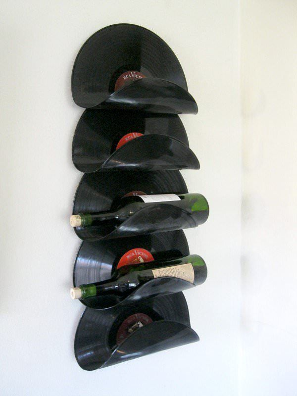 This is my prototype for a wall-hung wine rack made from old vinyl records. The records appear to float with no visible supports. On the back side, you can see how it is done. A wood 1x4 provides the support…