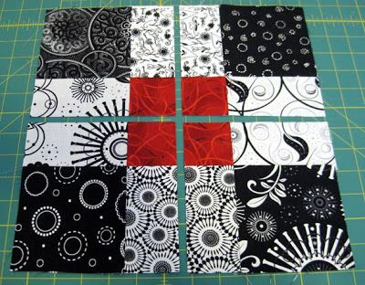 LOVE the contrast of the black, white, and red colors!! Valentine Quiltworks: Disappearing 9 Patch Quilt
