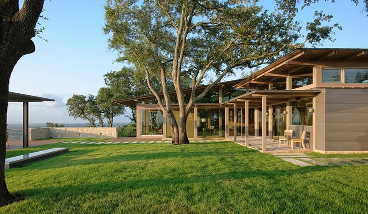 lake flato's hillside house in texas overlooks downtown austin