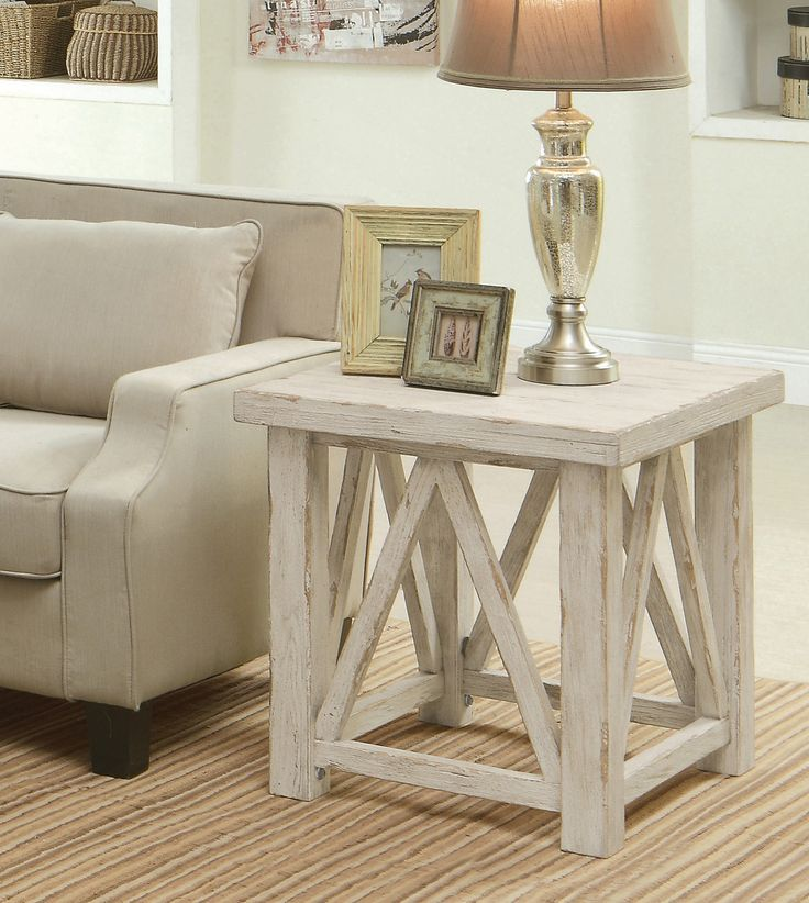 The Aberdeen end table brings a rustic feel to any room with its wire-brushed veneer and weathered worn white finish. The hand-crafted distressing brings the charm of an antique that will fit in any setting.