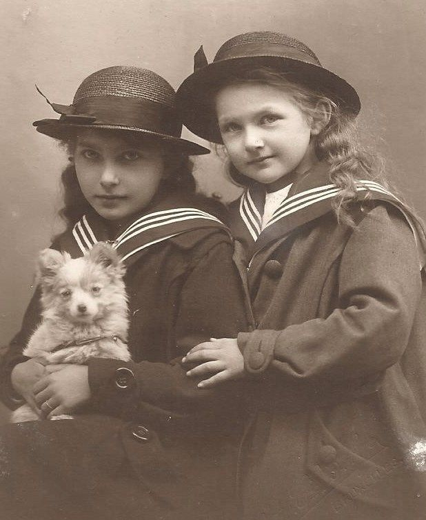 Sailor girls with their dog