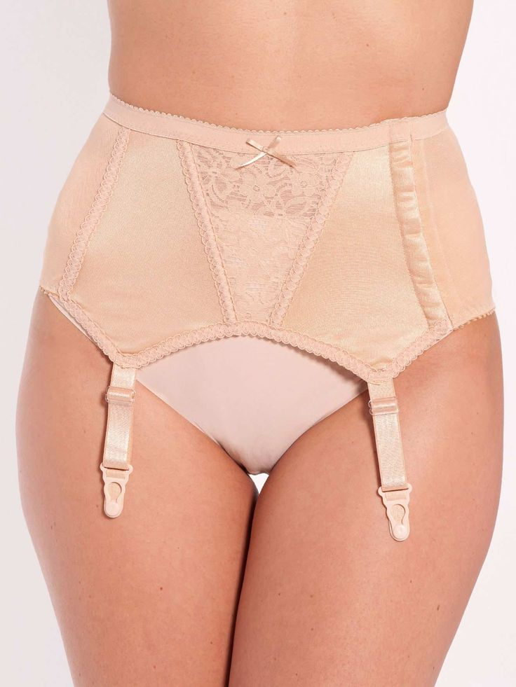 Firm-support suspender belt. Lingerelle £42.00 Product Reference: 1272855 V-shaped lace panel with tulle lining and flexible stays. Sides in smooth knit fabric with cotton lining. Back in stretch tulle. Wide flat elastic at the waist. 9-position, double-hook side fastening. 4 fixed suspenders. 80% polyamide, 15% cotton, 5% elastane