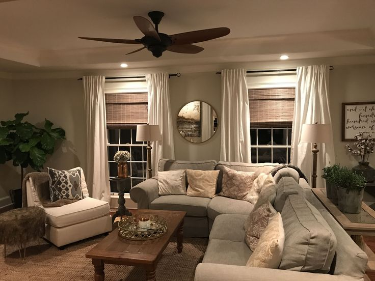 Cozy modern farmhouse family room with a natural jute rug, grey slip covered sofa, woven wood blinds, white curtains, fiddle leaf fig tree, succulents, etc. Joanna Gaines would be proud!! #familyroomdesignideas