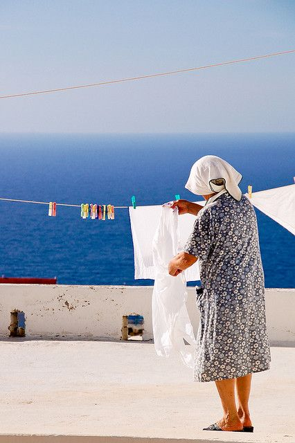 This is my Greece | Woman hanging up clothes in  Karpathos, Dodecanese
