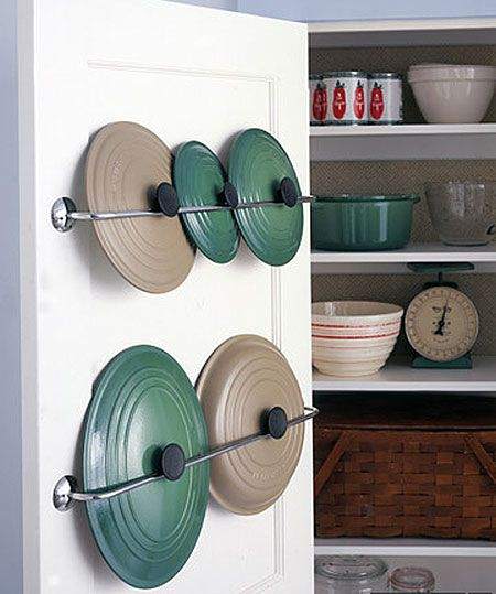Pot lid storage. Install metal towel bars inside your pantry door. Don't use fancy or bulky bars -- look for simple ones that stand out about 2 inches; mount them only to the rails of solid-core wooden doors. To hang a lid, slide it behind the bar so the knob or handle catches and holds the lid in place.
