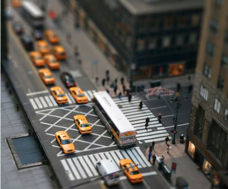 "Miniature Photography: ""Tiny New York"" Fake Tilt Shift done in PhotoShop by Ian Payne. The shallow depth of field makes it seem like a close-up photo, tricking the eye into believing those yellow cabs are the size of a quarter."