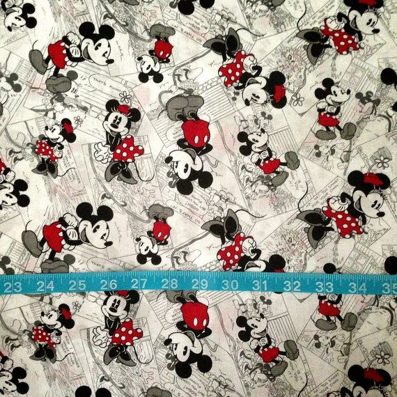 Mickey & Minnie Mouse Vintage Look Fabric-Cotton Woven via Etsy  Recovered my memory boards with this fabric, red ribbon, and big yellow buttons