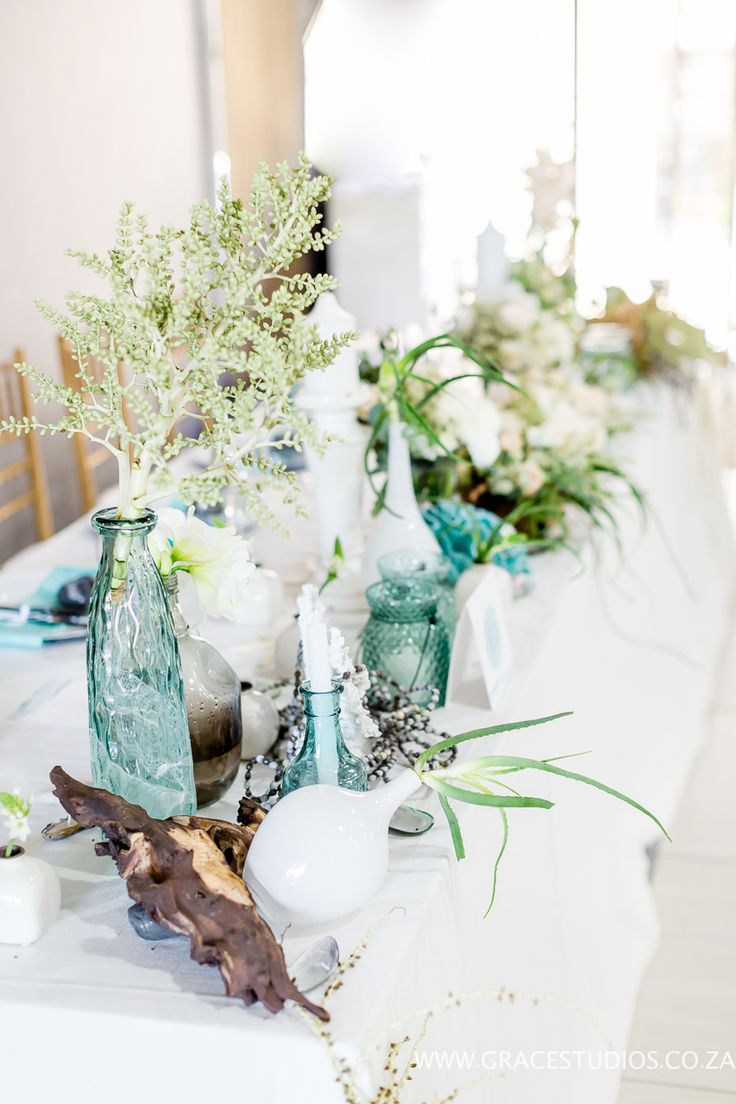 Teal Turquoise Inspiration, drift wood, beach wedding decor, luxury south african beach wedding, palm berries   http://www.absoluteperfection.co.za/#!CHANTELLE-AND-RJS-ROMANTIC-INTIMATE-BEACH-WEDDING/c1jar/57ad8b610cf2d58e4d0423e6