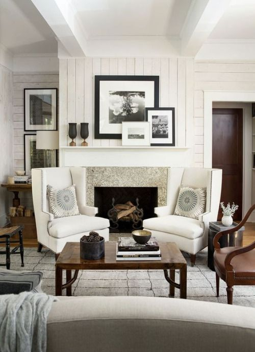 Beautiful frames in a fabulous, cozy living room space.  Fireplace surround stone. Color and decor over mantle