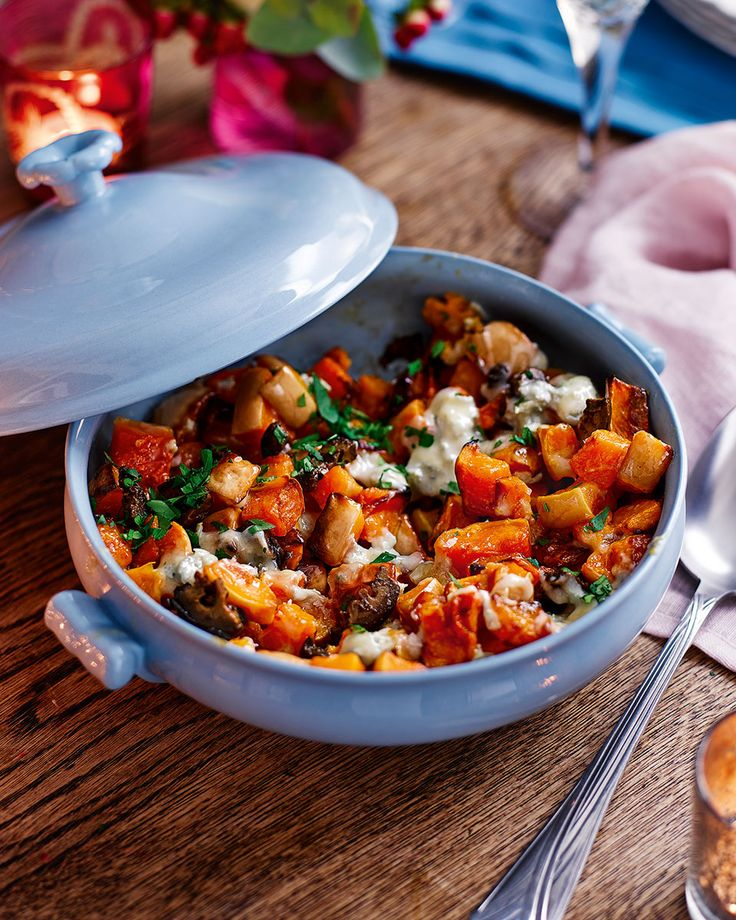 Roast squash with tangy blue cheese and crunchy walnuts is the perfect side recipe for a cold day.