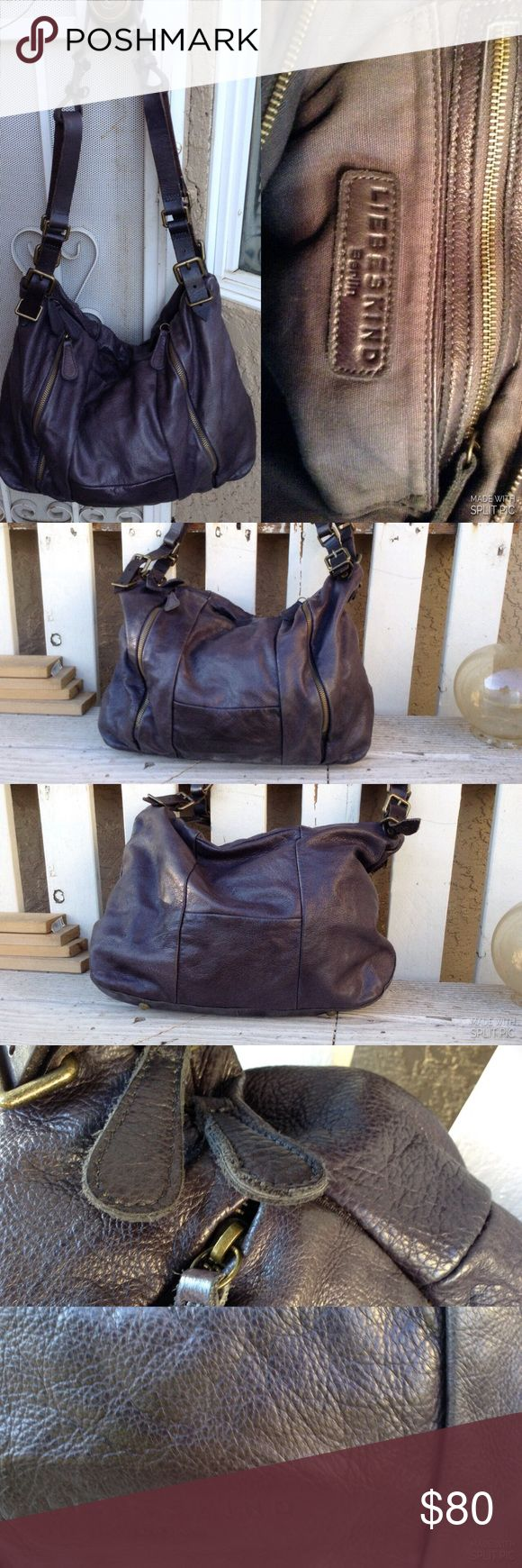 Like new Liebeskind bag Beautiful supple leather slouch bag, deep mauve in color, with four rounded feet on bottom. No stains or marks. Beautiful bag. Enjoy Liebeskind Bags Shoulder Bags