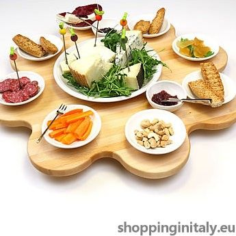 Girovago is a turning serving board perfect for an intimate dinner or a sushi party. #turning #serving #board #wood #shoppinginitaly #madeinitaly #kitchen http://www.shoppinginitaly.eu/product/girovago-turning-serving-board/