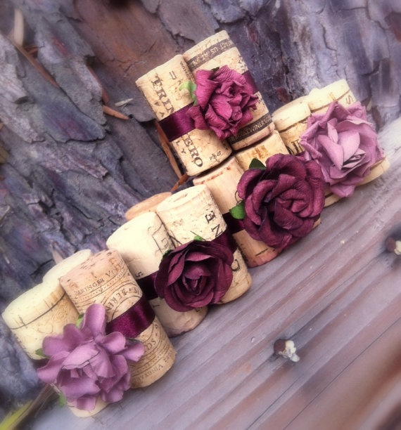 If you like these placecard holders, we could probably make them using a glue gun and just ribbon instead of flowers.  Gotta start saving corks.  :)