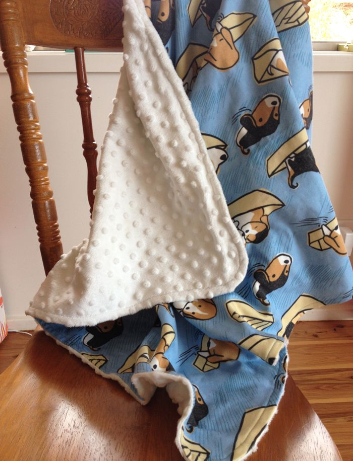 Baby blanket with gorgeous puppies fabric designed by Cecilia Mok (cecilia_mok on Spoonflower) and Minky Dot fabric on the back.
