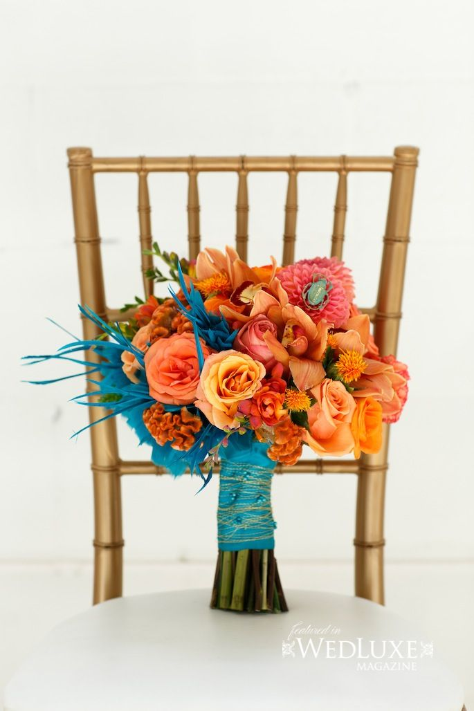 A collection of orange dalias, roses and orchids..  photo credit @visual cravings