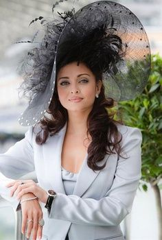 .big airy black feathery hat