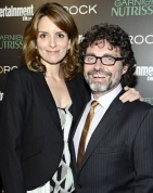 Tina Fey & husband Jeff Richmond---love it when he cameos on the show. He's a wonderful composer and his music is almost its own character.