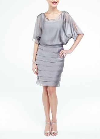 This chiffon blouson dress is ultimately flattering for any affair!  3/4 sleeve blouson bodice is ultra-feminine and chic.  Short shutter tier skirt adds texture and creates a flawless silhouette.  Fully lined. Back zip. Imported polyester.  Hand wash cold separately. Use mild detergent. Hang dry, low iron as needed or dry clean. Cover trim before cleaning.