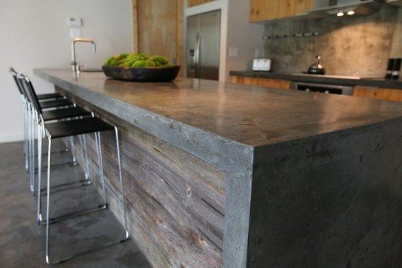 Plan de travail et bar en béton dans la cuisine    http://www.homelisty.com/plan-de-travail-cuisine-en-71-photos-idees-inspirations-conseils/