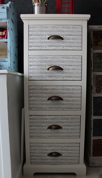 Decoupaged my drawer with music notes :)