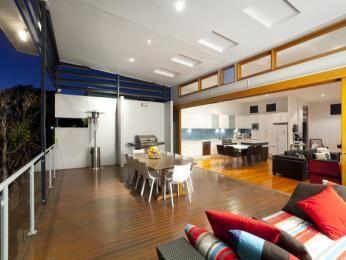 Indoor-outdoor outdoor living design with deck & decorative lighting using glass - Outdoor Living Photo 1438501
