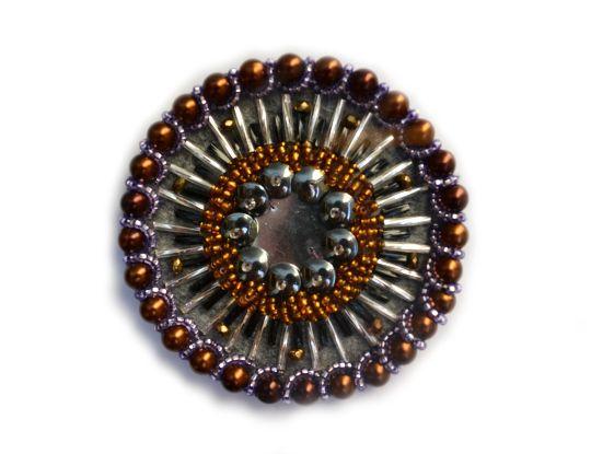 Tribal Fusion medallion, available on Etsy: https://www.etsy.com/se-en/shop/TribalNocturn?ref=l2-shopheader-name