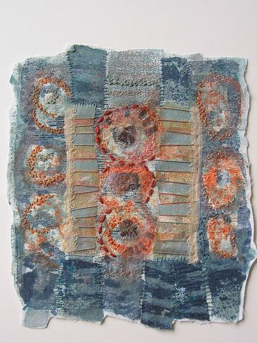 Fiona Rainford I like the combination of circles and broad and narrow stripes using complimentary colours.  It looks as if the piece has been produced lusing felt strips layered on top of eachother with some elements embroidered to highlight them.