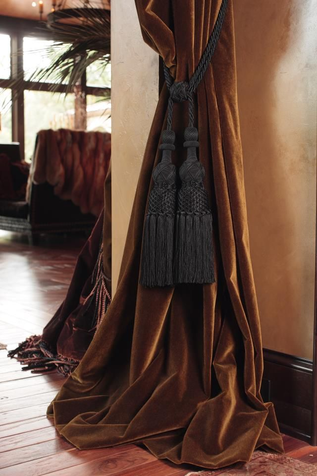 Chocolate velvet drapes puddle on the floor. The large chocolate tassels tiebacks work well with the weight of the fabric. I've used this detail at openings between rooms. It's always fun to line with a matching color satin or another accent fabric surprise.