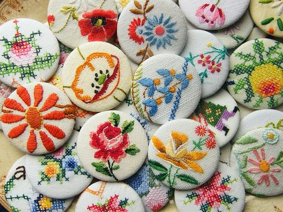 Beautiful embroidered covered buttons.  Here's a thrifty, crafty trick & tip:  If you're not good at embroidery then there's a 'cheats' way to get this result.  Visit your local Charity Shop (Thrift store for our USA folks) and seek out old embroidered table cloths and handkerchiefs which already have embroidery on them.  Cut out the sections of embroidery (making sure you don't snip the important threads) and use these sections to make your buttons!