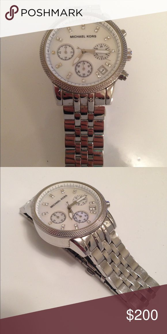 Michael Kors Silver Watch Mid size watch, in very good condition. Worn a few times, works like new! Michael Kors Jewelry Bracelets