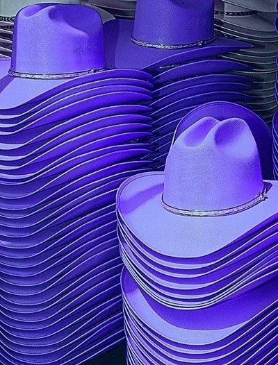 Stack of purple cow girl hats @ http://allthingsgraceful.tumblr.com