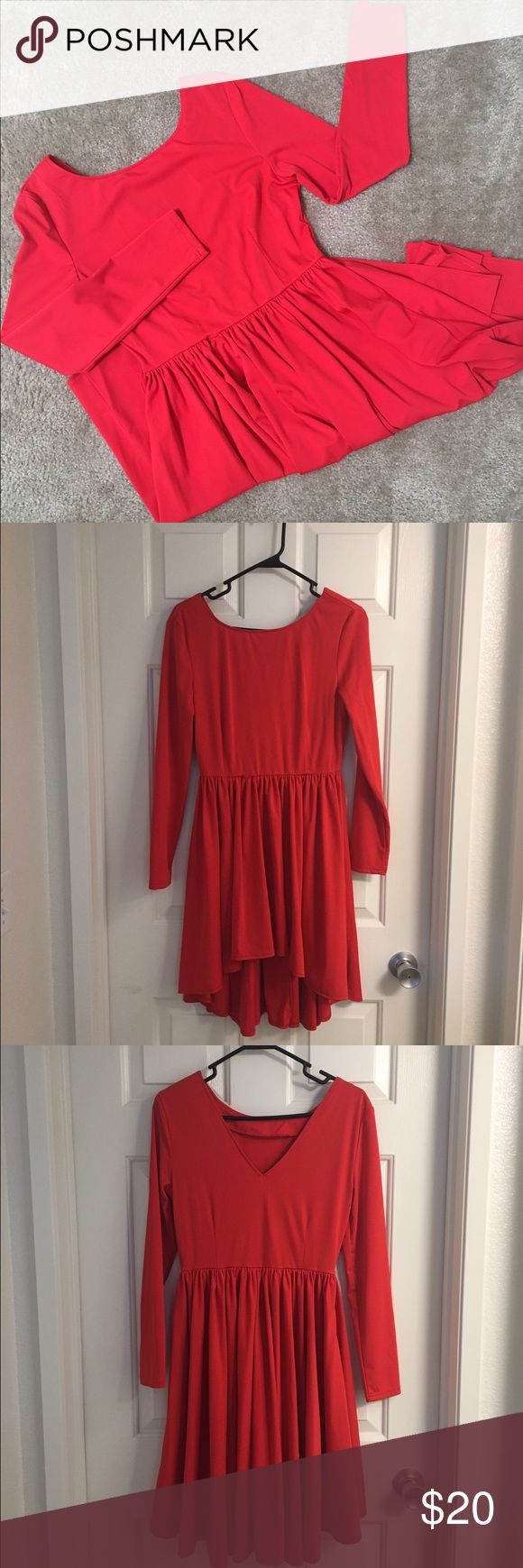 Red Ice Skater Style Dress Red Ice Skater High Low Style Dress. Tag size M. Dress has some stretch. V-neck back shown in picture. Worn once. Dresses High Low