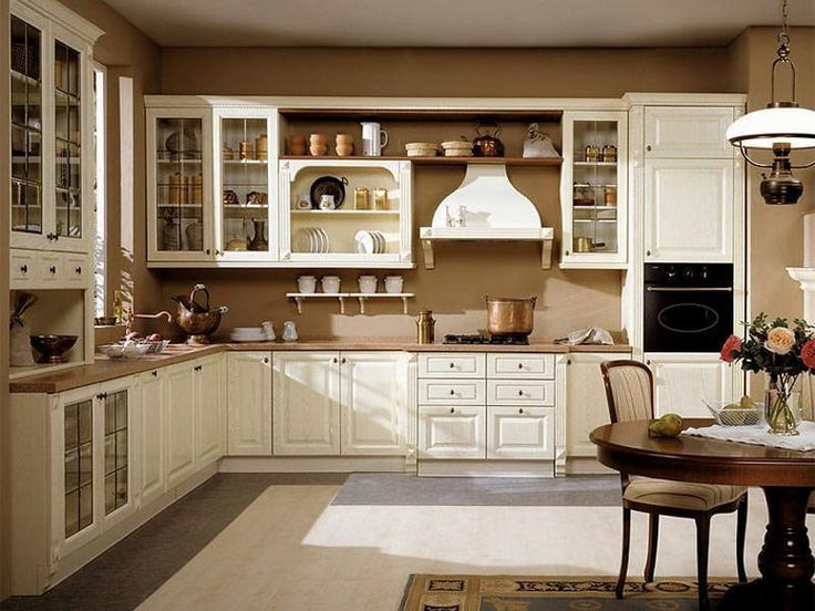 traditional country kitchen with white glass cabinets and dark brown walls