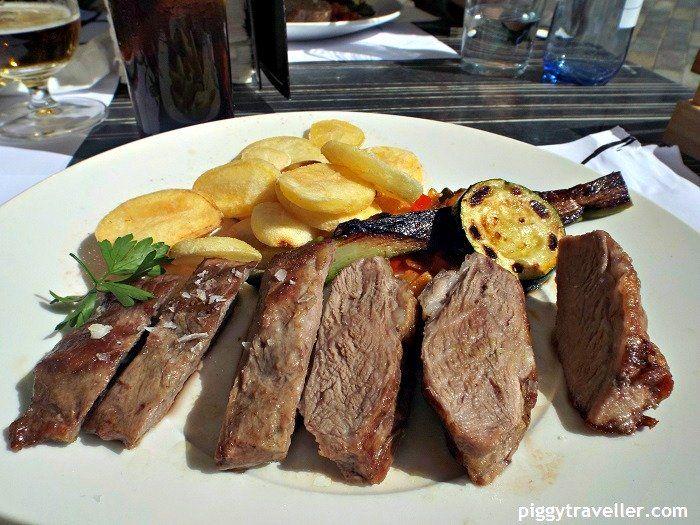 Presa ibérica (Iberian pork cut), served with grilled vegetables and fried potatoes. Restaurante La Minerva, Cáceres. http://www.piggytraveller.com/eating-caceres-restaurante-la-minerva/