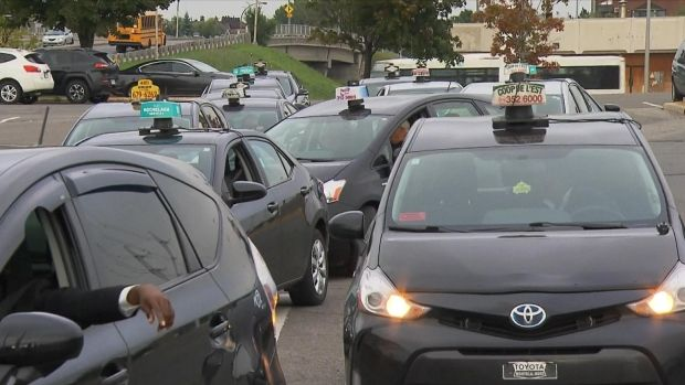 Taxi drivers left from Anjou, in east end Montreal, on Wednesday morning and drove toward Quebec City for a protest in front of the National Assembly.