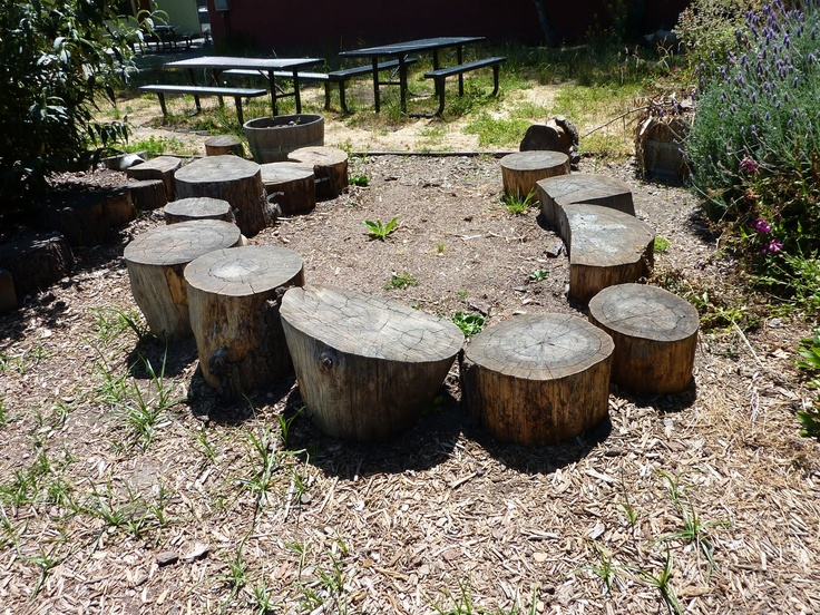 Log benches as a gathering space for the school garden - I want this at Brecknock back at the vegetable garden!