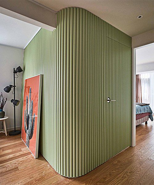 the green curved walls in this seoul house feature hidden storage, by daniel valle architects