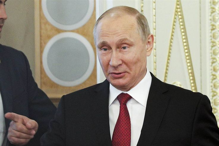 At an economic forum in St. Petersburg, Russia, Putin also waved off the idea that hacking could have a meaningful influence on an election.