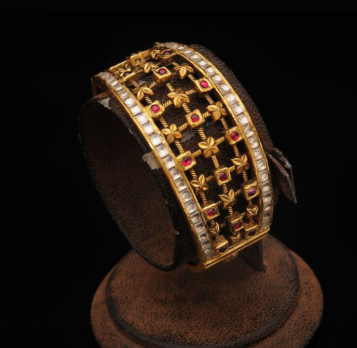 Antique Kada Bangle - like the inside work but not the border work. Would like it to be just plain gold instead of the white stones.