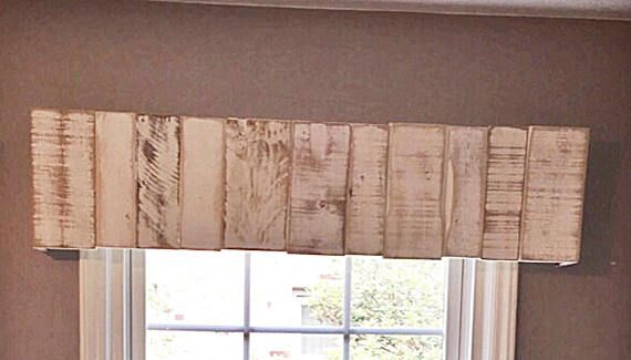 Need a rustic wooden valance to bring style to an old window or do you love the farmhouse feel? These rustic window valance are custom made from recycled pallet wood and distressed to a farmhouse finish. It measures 10 1/2 wide 4 1/2 deep and the length will vary. Mounting hardware